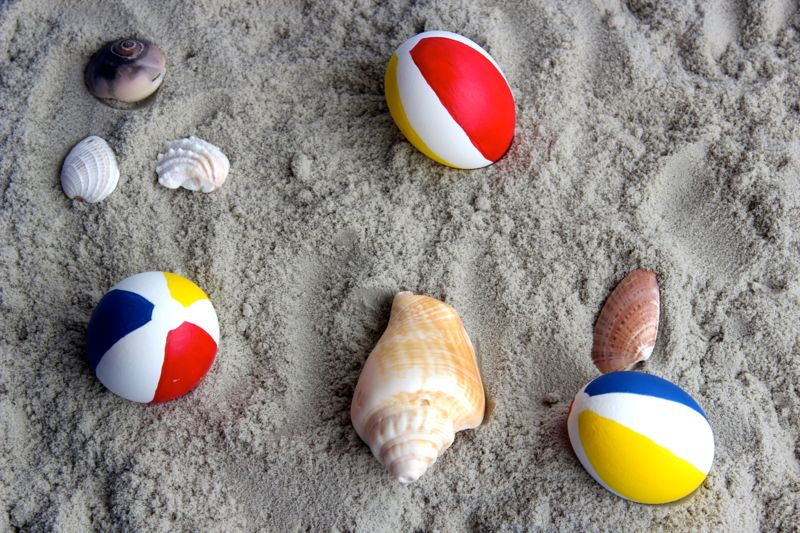 dig-beach balls-easter-eggs-red-yellow-blue