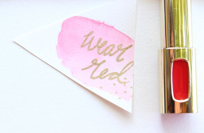 wear-red-lipstick-pink-watercolor-gold