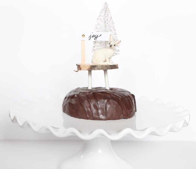 chocolate-cake-wood-slice-rabbit-tree-white-joy-sign-diy-cake-topper