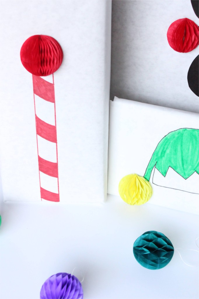 white-wrapping-paper-honeycomb-balls-colors-rudolph-elf-hat-north-pole-charlie-brown-christmas-tree-diy