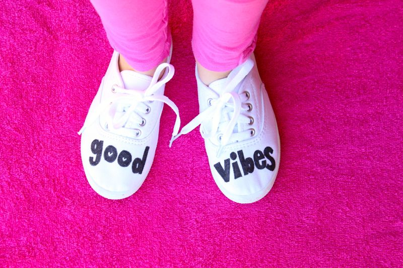 good-vibes-white-shoes-pink-floor