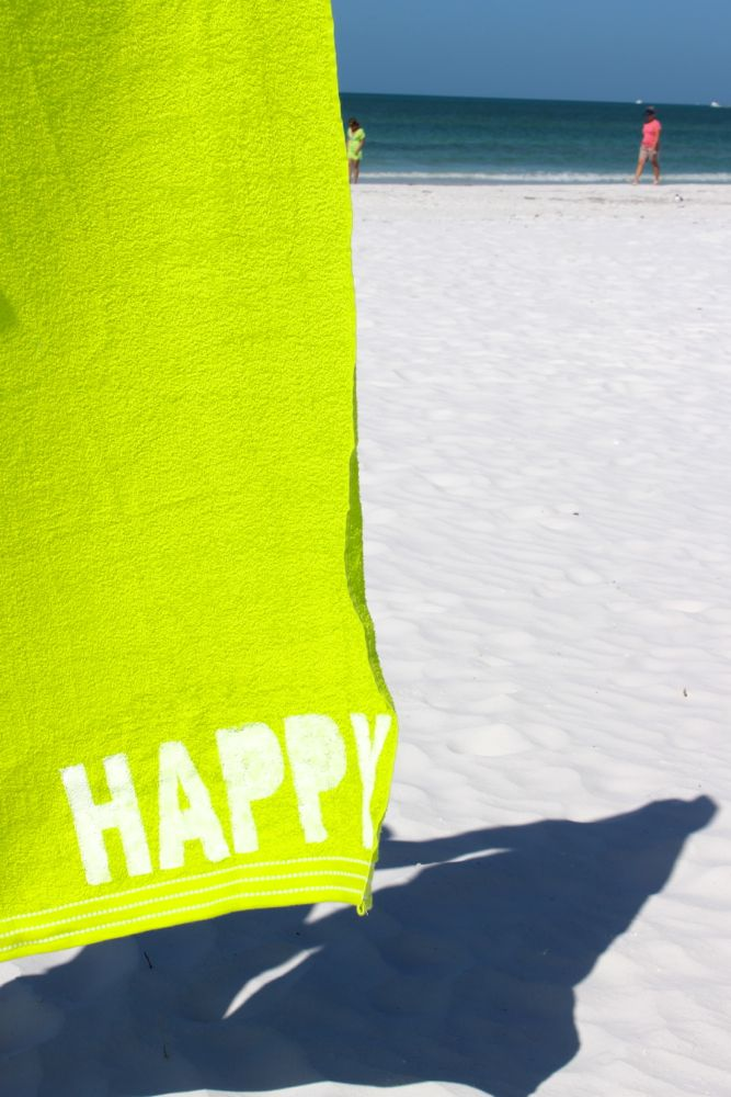 happy-green-towel-beach-white-sand