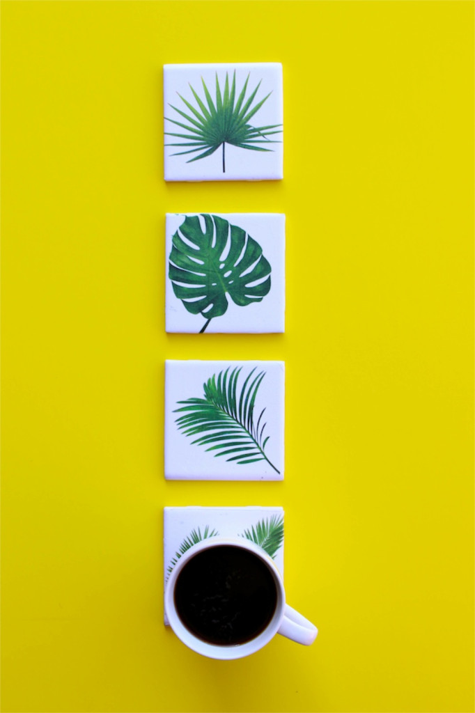 tropical leaf coasters with a yellow background