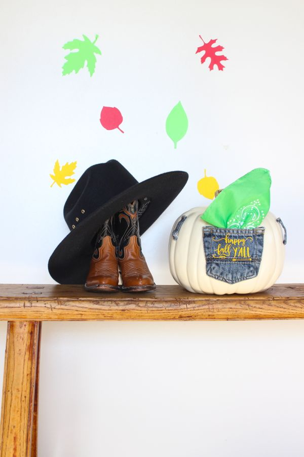 fall-bench-with-cowboy-boots-hat-pumpkin-jean-pocket-leaves