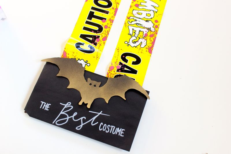 diy-halloween-best-costume-award-caution-tape-bat