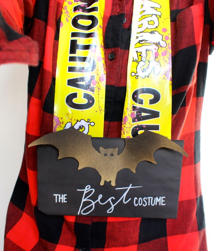 diy-halloween-best-costume-award-caution-tape-bat-medal