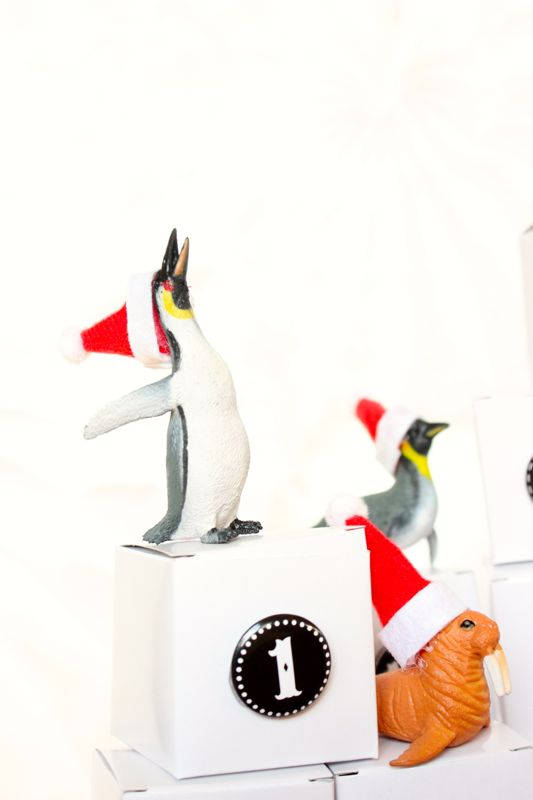 black-white-numbers-diy-advent-calendar-mini-santa-hats-toy-animals-penguin