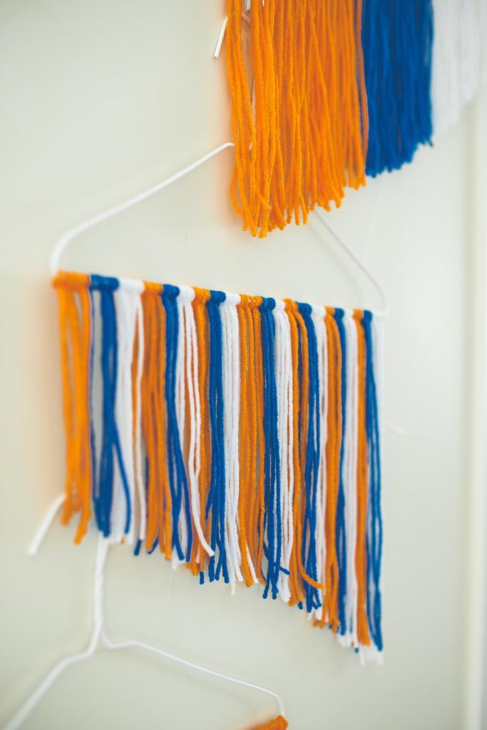diy-yarn-wall-hanging-orange-and-blue-broncos-party-photo-backdrop