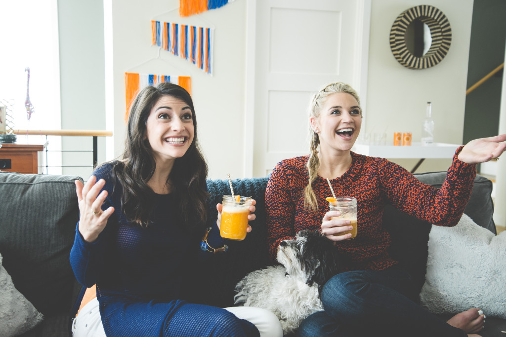 ladies-smiling-game-time-orange-cocktail-fun-party-bronco
