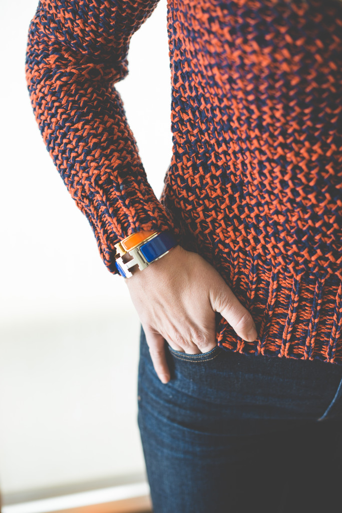 blue-sweater-woman-orange-jeans-fashion-bracelet