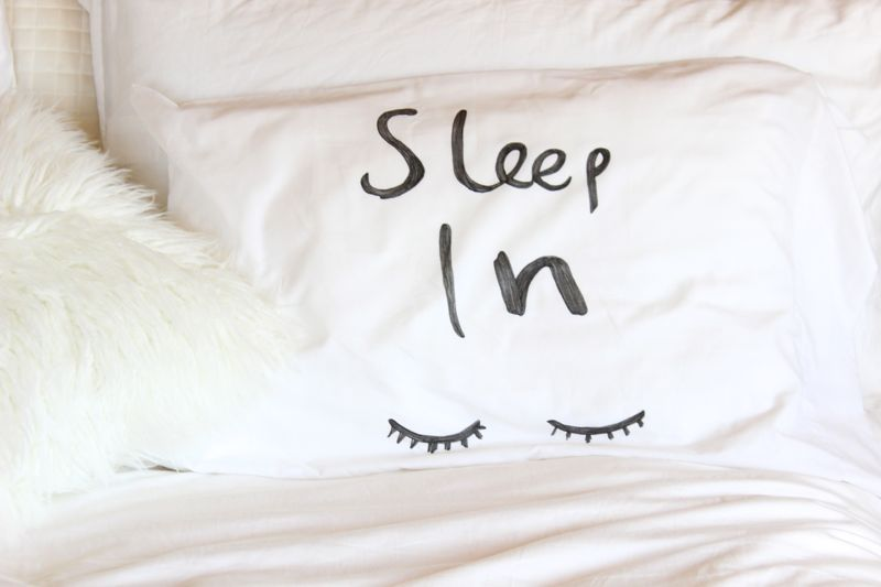 sleep-in-pillow-white-bedding-eyelashes-black-and-white
