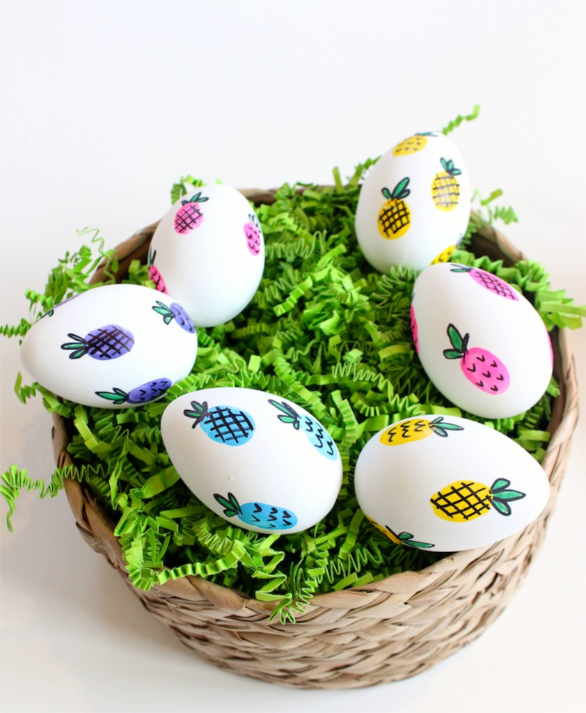 easter-eggs-in-a-basket-with-colorful-pineapples-and-green-grass