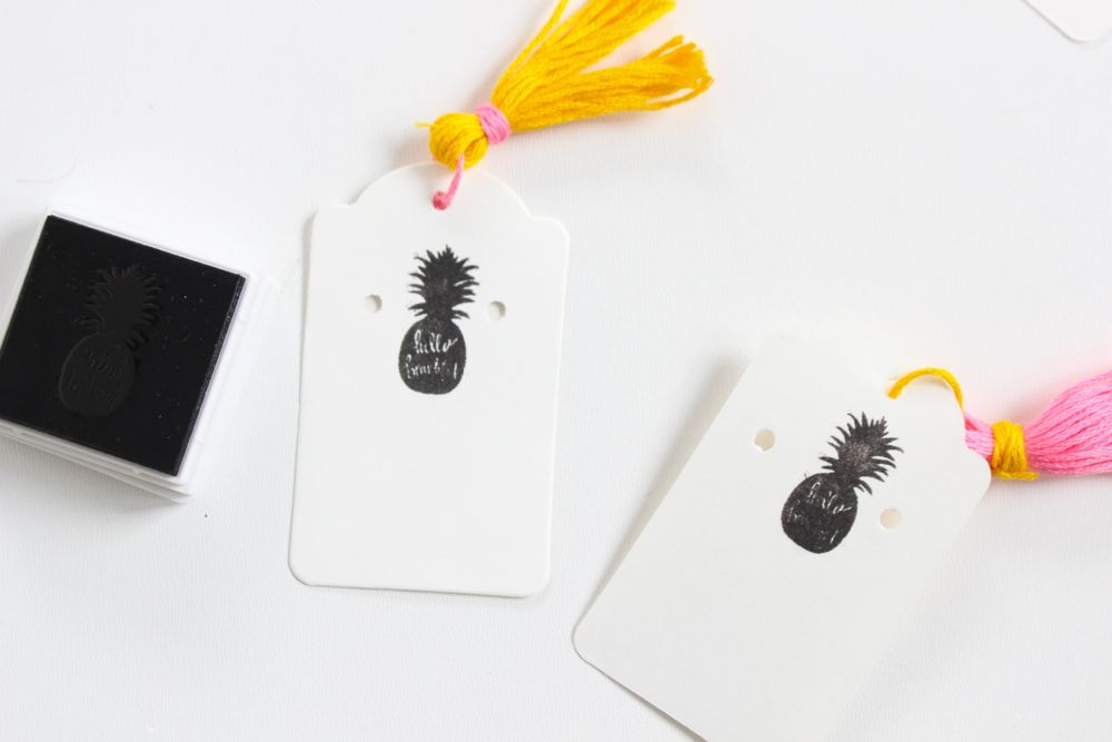 card-stock-with-black-pineapple-stamp-and-yellow-tassel