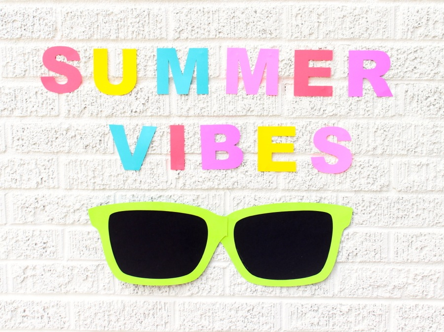 colorful-summer-vibes-paper-wall-decor-and-a-giant-pair-of-green-paper-sunglasses