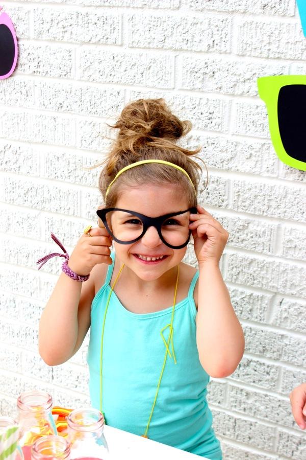 girl-wearing-black-paper-sunglasses
