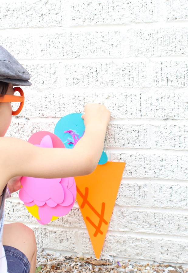 kids-taping-ice-cream-scoops-on-a-wall