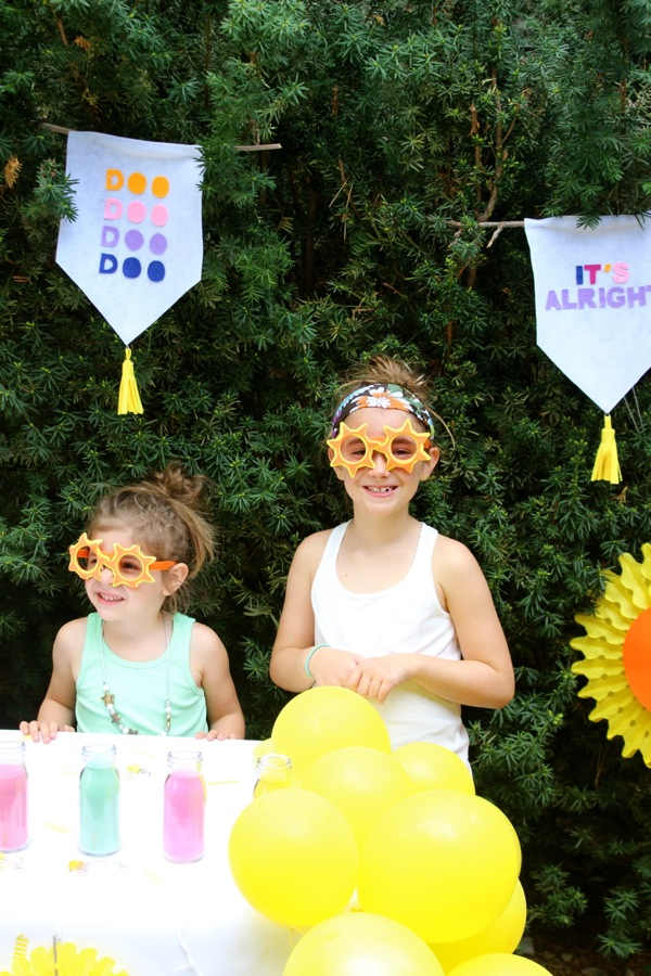 here-comes-the-sun-party-with-two-girls-wearing-sun-sunglasses