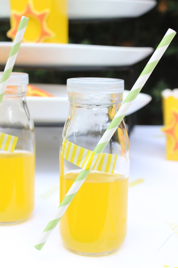 glass-milk-bottles-filled-with-juice-and-a-straw-taped-to-the-outside