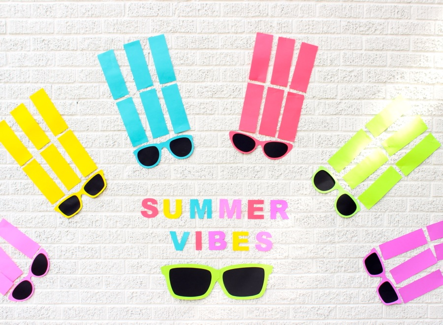 summer-vibes-paper-backdrop-colorful-sunnglasses-arched-like-a-rainbow