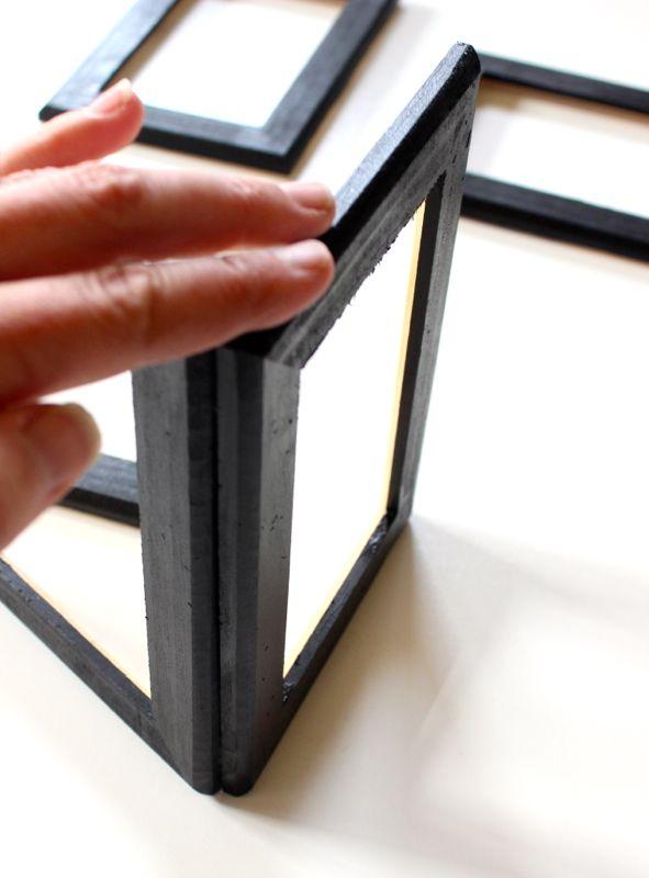 hand-holding-a-black-frame