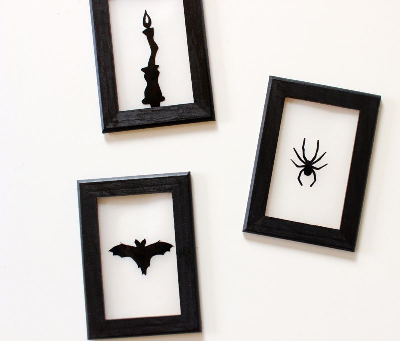 black-halloween-silhouettes-bat-spider-and-candle-on-vellum-paper