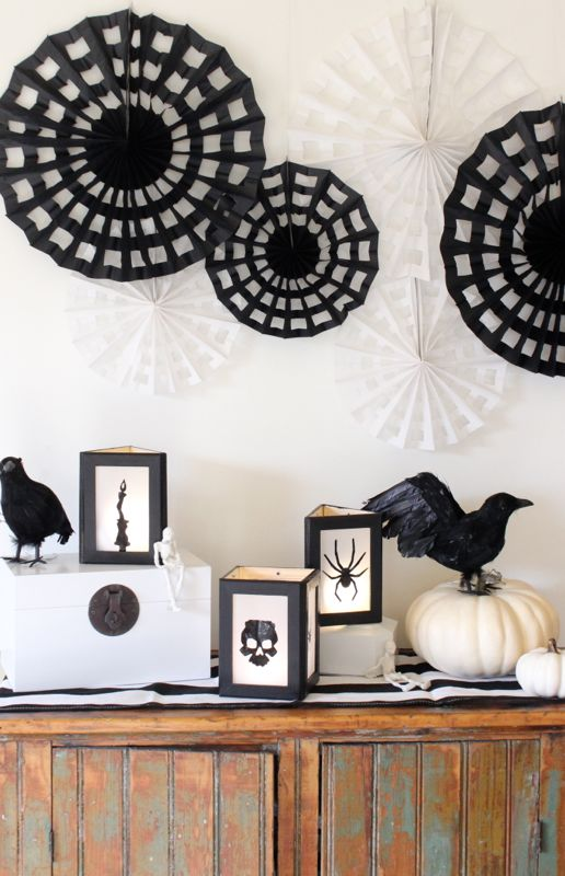 black-and-white-halloween-decor-with-spider-and-bat-silhouette-lanters