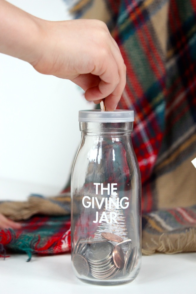 the-giving-jar-with-hand-dropping-money-in-a-mini-mik-bottle-coin-bank