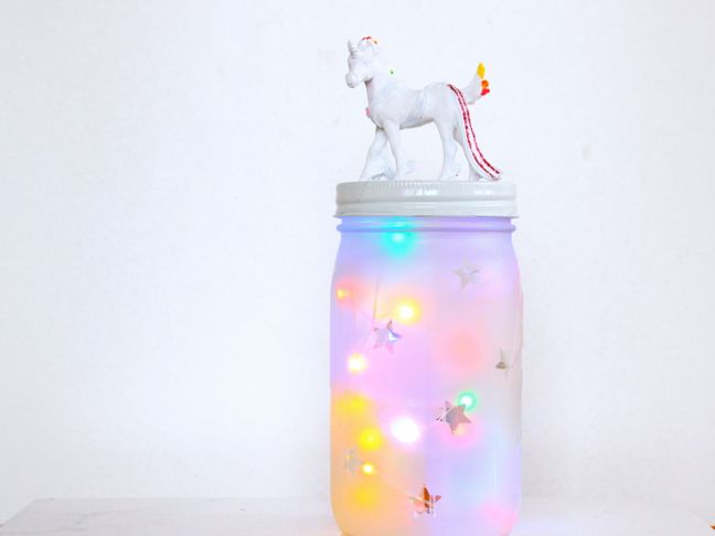 mason-jar-night-light-with-a-white-unicorn-on-top-rainbow-twinkle-lights-inside