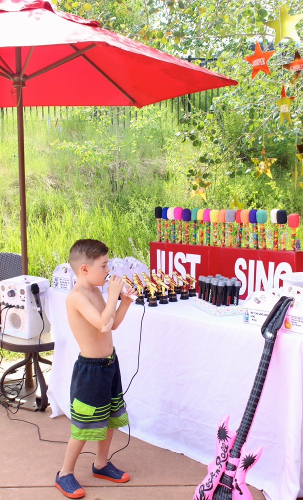 boy-singing-at-a-sing-party