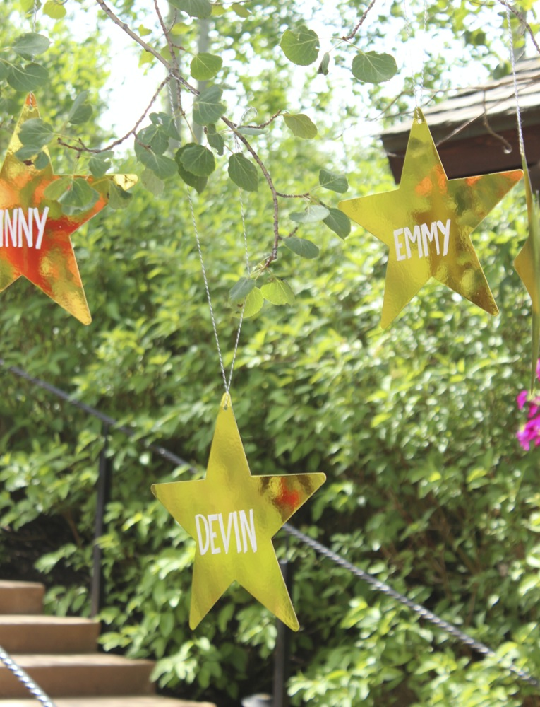 gold-stars-with-names-on-them-hanging-from-a-tree