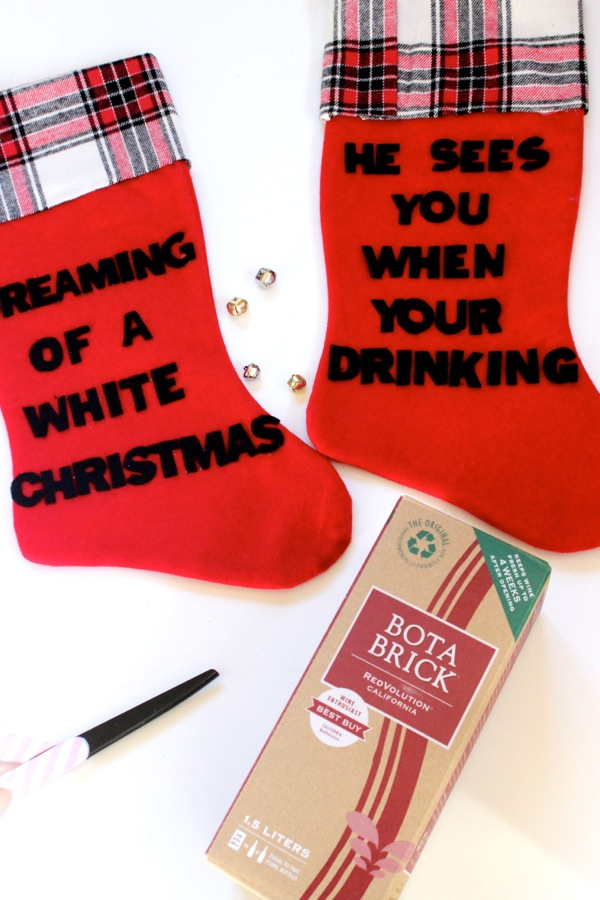 red-and-plaid-stockings-with-funny-lines-diy-boxed-wine-stocking-holder