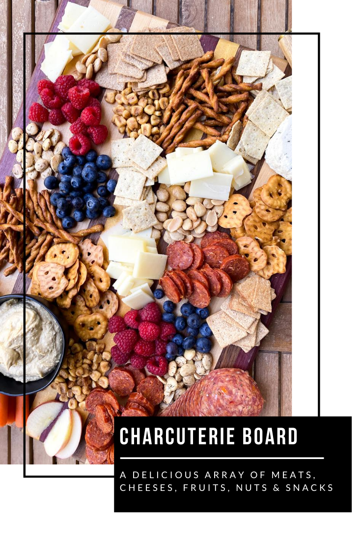 charcuterie board with meat cheese and snacks
