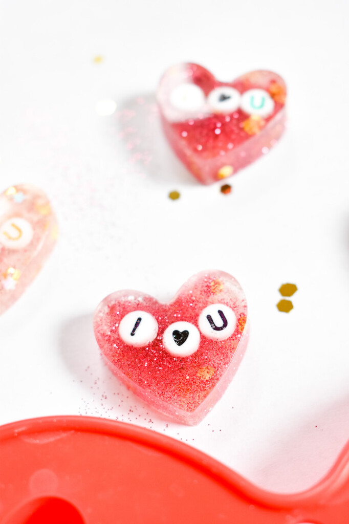 diy resin hair clips with glitter and heart sequins